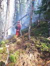 Tpr Thibault hosing down a flare up at Juliett Creek. Photo by Cpl Daniel Wynen